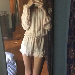 Long sleeve peach colored romper